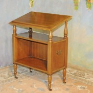 A029 Vintage Booktable. An antique reproduction with solid brass casters and side handles