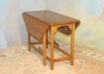 #707  Vintage Dropleaf chairside table.  Solid cherry, new condtion with gateleg design