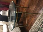 #271 Beveled glass and brass table with fluted legs and splayed feet